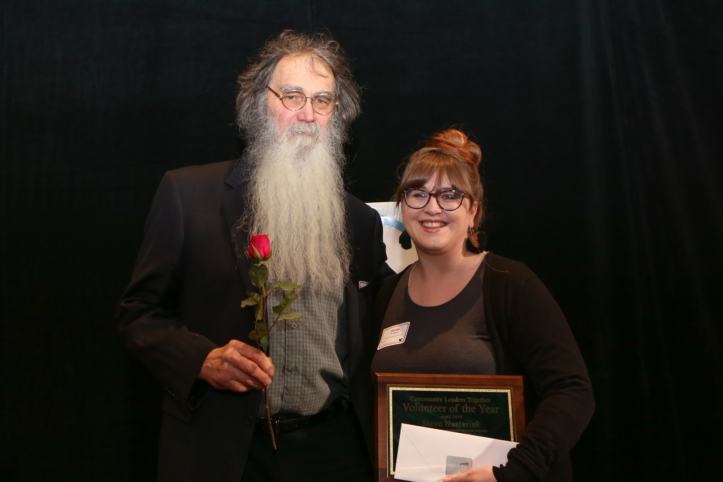 Looking Glass volunteer Steve Nastasiuk graciously accepts his award from Ashlee Jacobson from SELCO, who presented the awards in the Education & School Volunteer category.