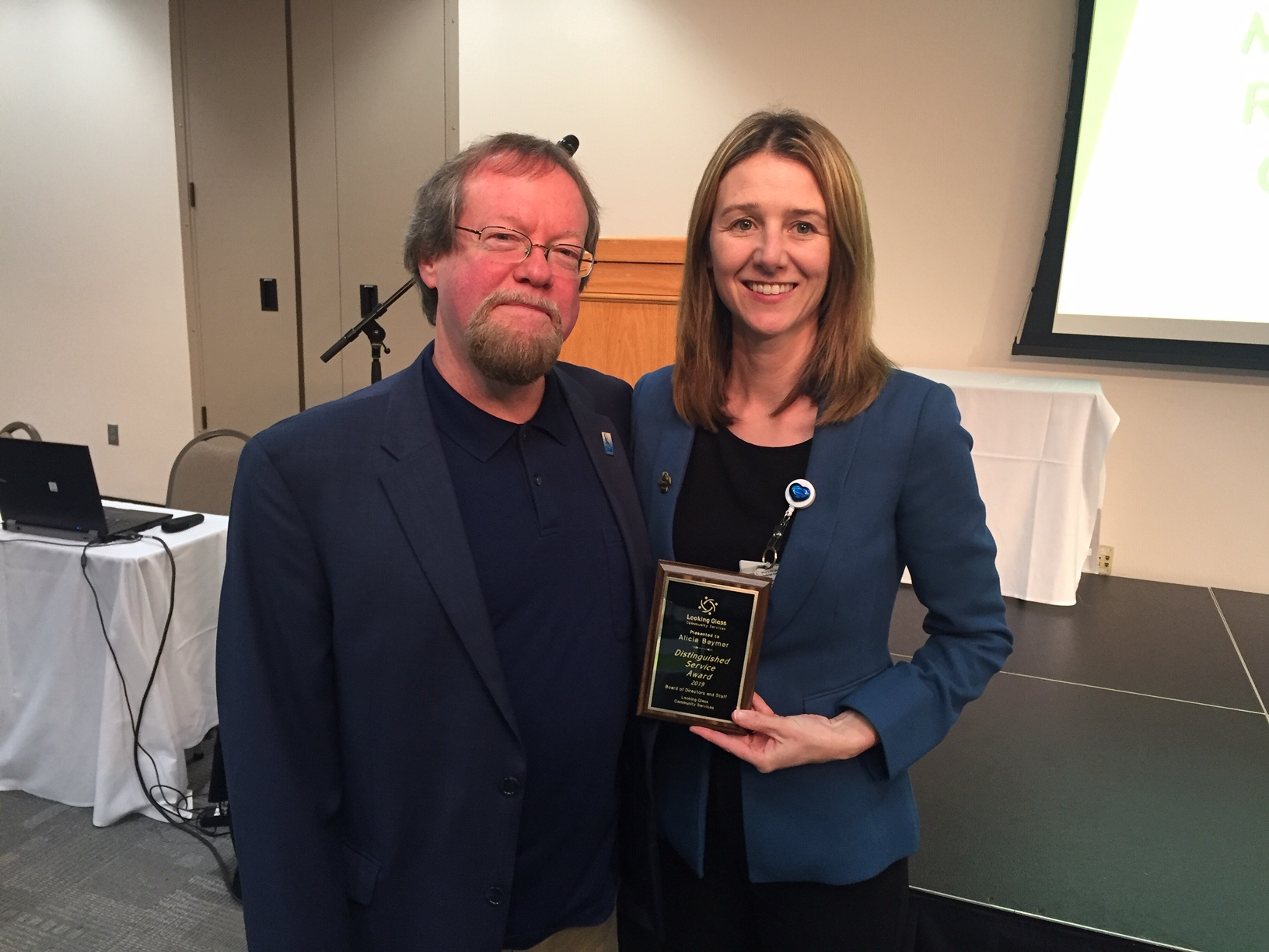 Looking Glass CEO Craig Opperman stands with PeaceHealth Director of Home Care Services Alicia Beymer after presenting her with a Distinguished Service Award.