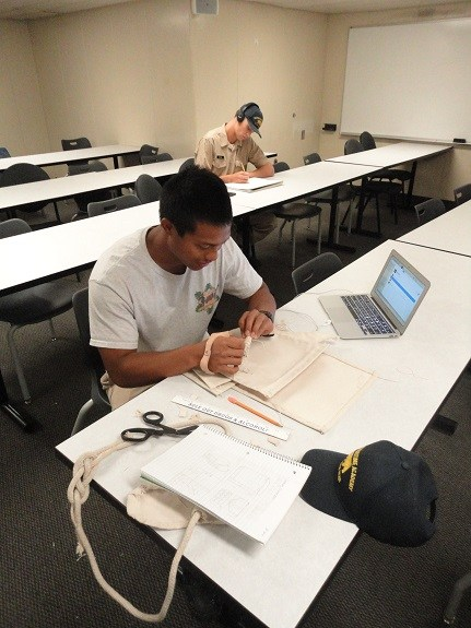 Our 2016 scholarship recipient Duke Quitevas, working on his sail bag creation while on the training cruise headed to Hawaii.