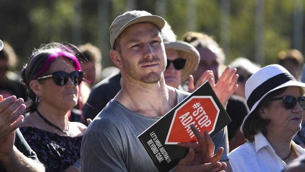 David Pocock attends a protest outside Parliament House in Canberra in February against the proposed Adani coal mine. Picture: AAP