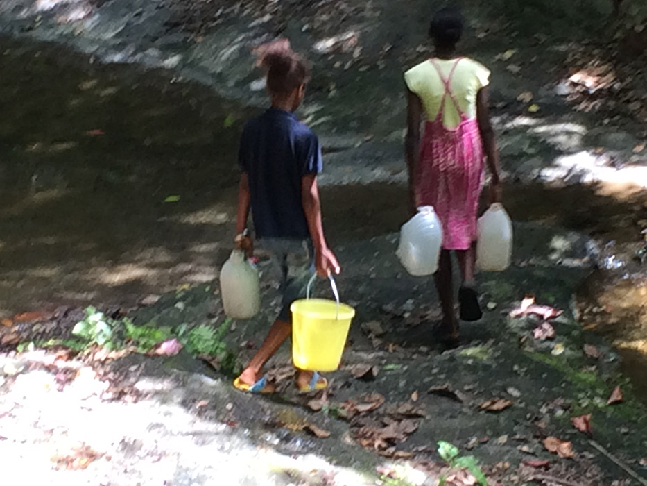 Several children making their daily water collection at the local river near El Toro.