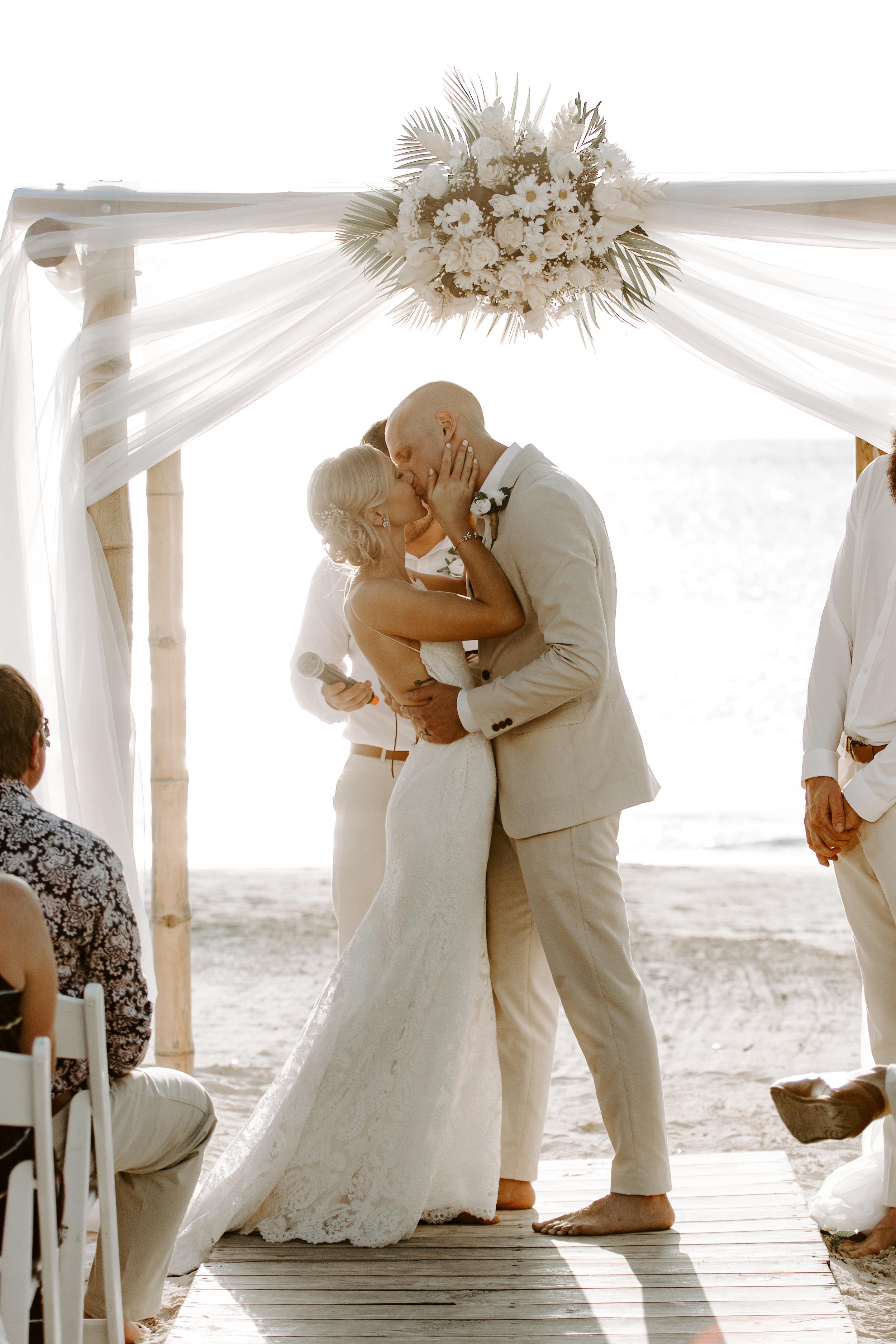 beach wedding, beach wedding ceremony, i do, bride and groom, beach wedding dress, first kiss, backless wedding dress, backless dress, katie may, katie may bridal, destination wedding, jamaican wedding, define fettle