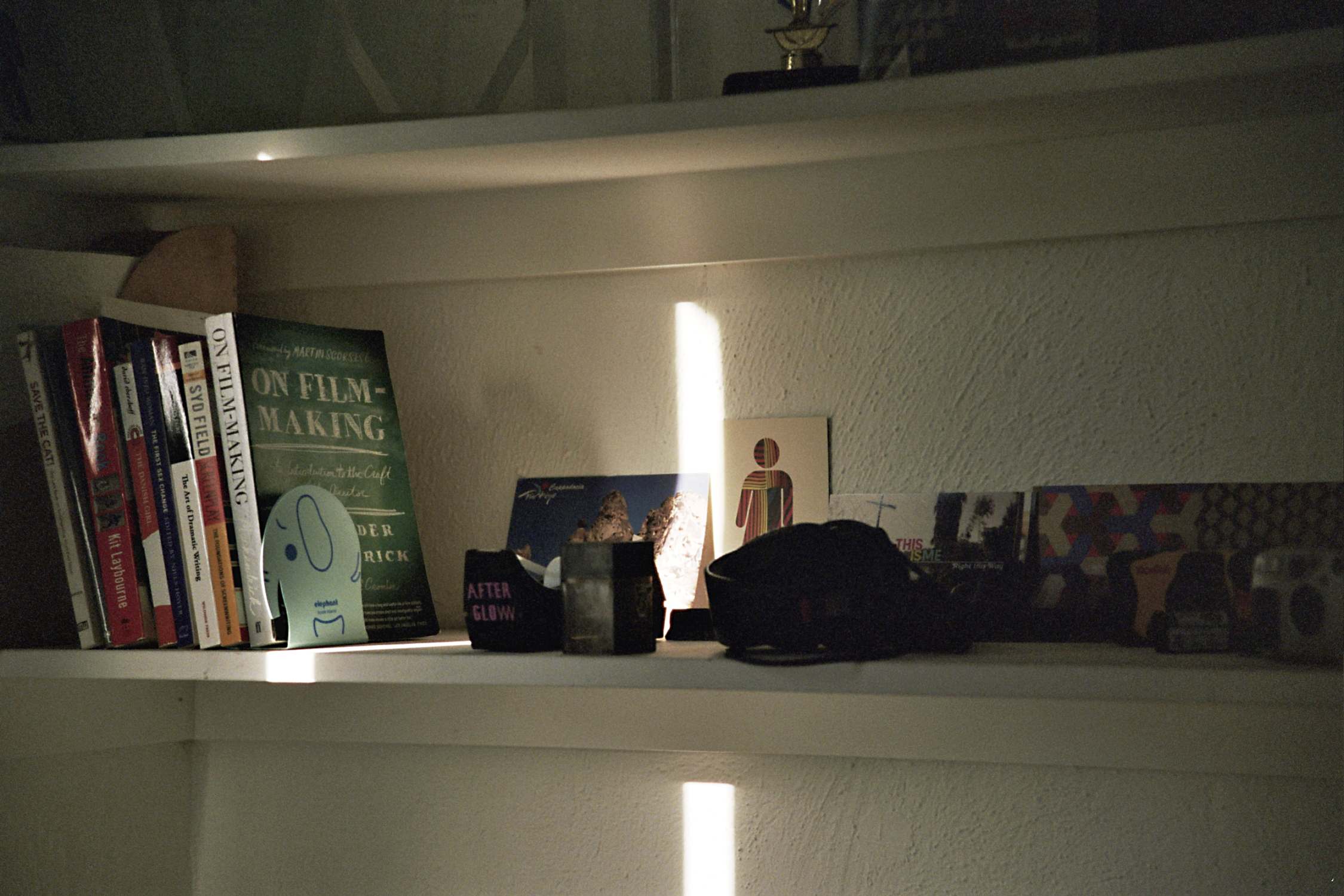 A shelf in Ernst's Silver Lake apartment provides a perch for mementos and meaningful  tchotchkes .