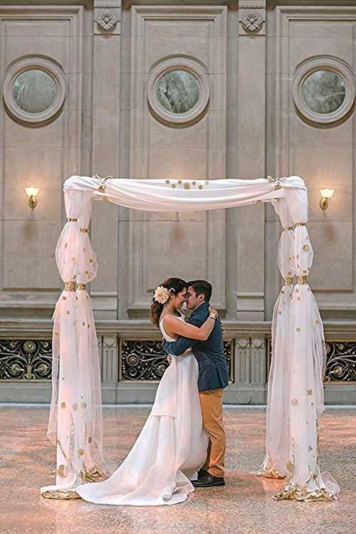 For the chuppah to hold a room as large as this one, I chose bold and delicate materials.