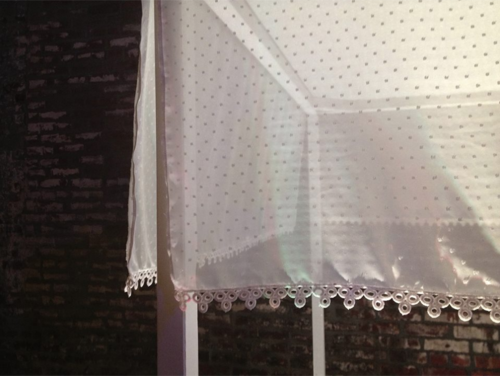 A custom silk canopy with a swiss dot pattern...
