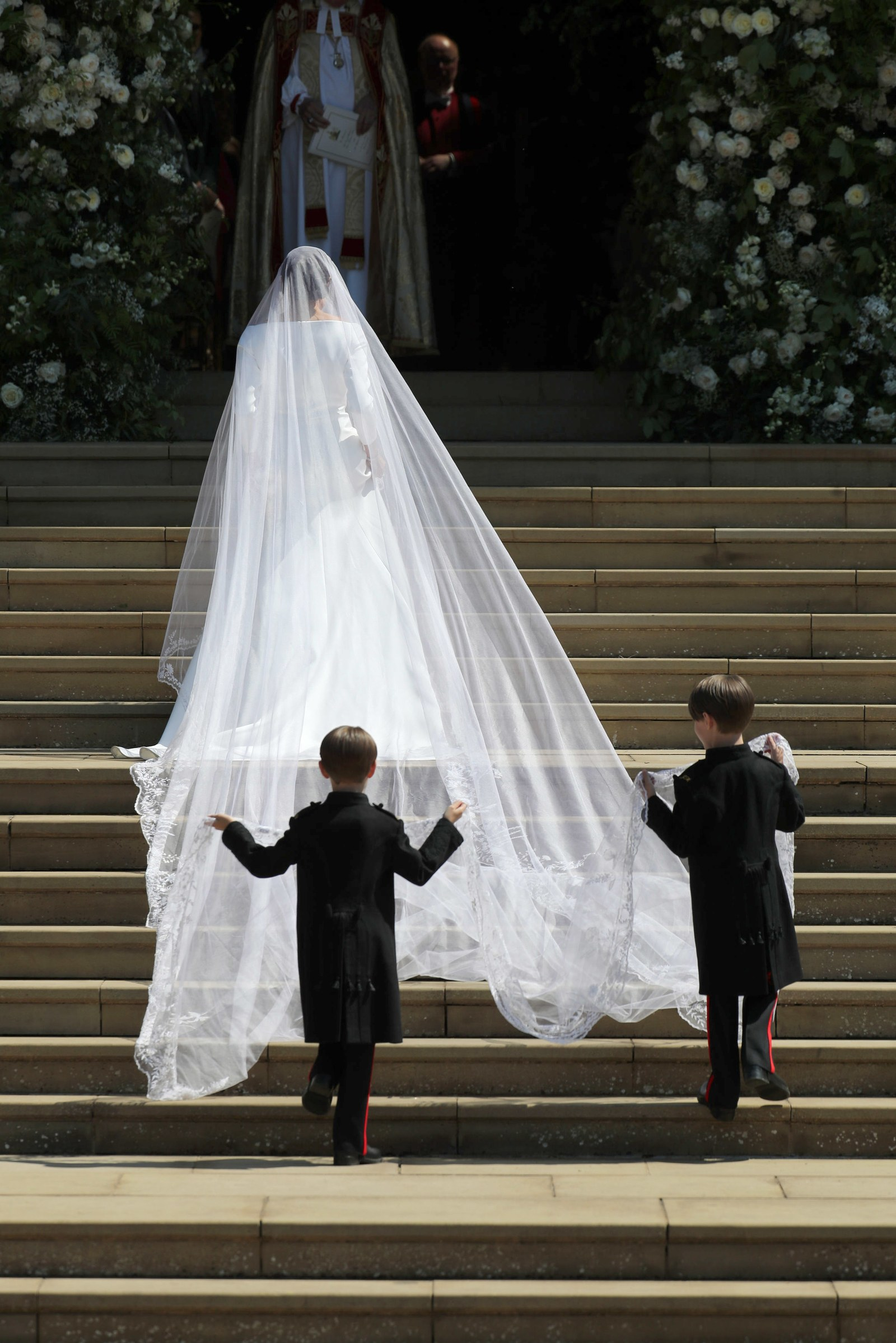 The Duchess of Sussex with her cathedral-length veil. Photo: glamour