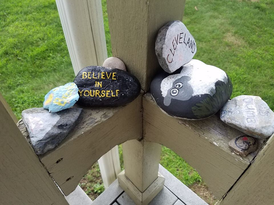 Photo courtesy of D. Santucci. Painted rocks collected from trails and mountain tops line this hiker's porch.