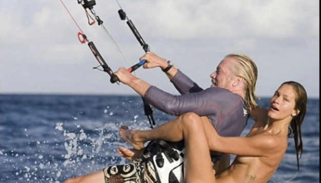 Is that richard branson kitesurfing with a hot girl on his back
