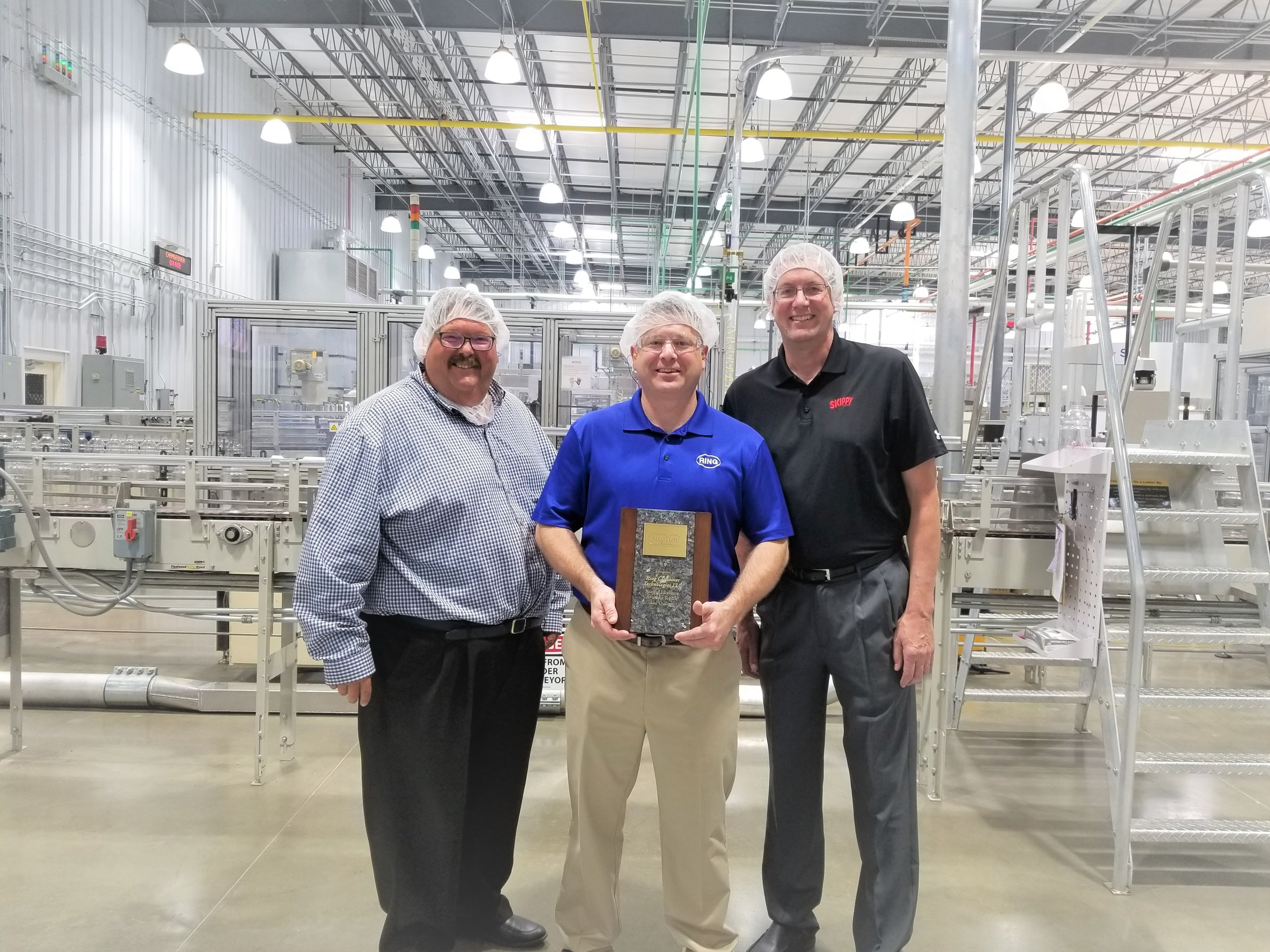 Bill Hacker, Hormel corporate buyer, Ray Lovelace, Ring Little Rock plant manager, Roger Vos, Skippy Plant Manager