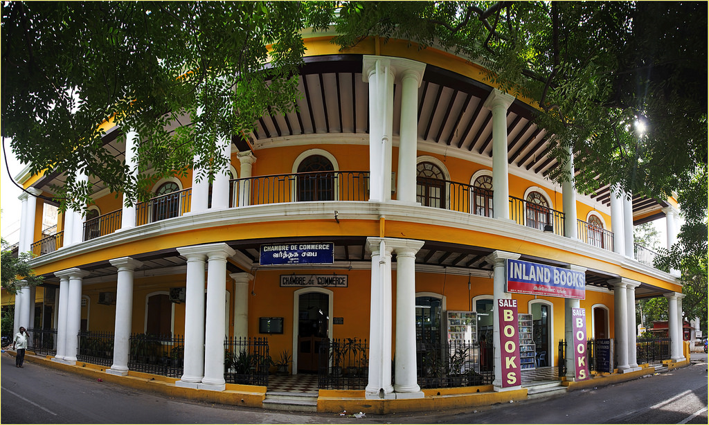 Pondicherry is the largest French colony in India. The city has a long and interesting history of trade and war. There is a strong French influence in the city, especially in the old quarters, with Rues and Boulevards lined with Mediterranean style houses and bakeries, although the city remains very much Indian. French is still understood, and the whole city makes for rather pleasant mix of East and West. It is also known as The French Riviera of the East (La Côte d'Azur de l'Est). If you've spent some time in Tamil Nadu and approached Pondicherry by land, you'll very likely experience mild culture shock on discovering French architecture and restaurants serving steak and good wine. Pondicherry is very much a city with a dual personality: crossing from East to West of the central canal reveals two cities with very different characters.