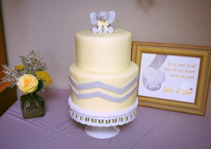 Gender neutral baby shower with butter yellow & gray color scheme                            Cake:   Ciao Bella Cakes  // Print: Etsy