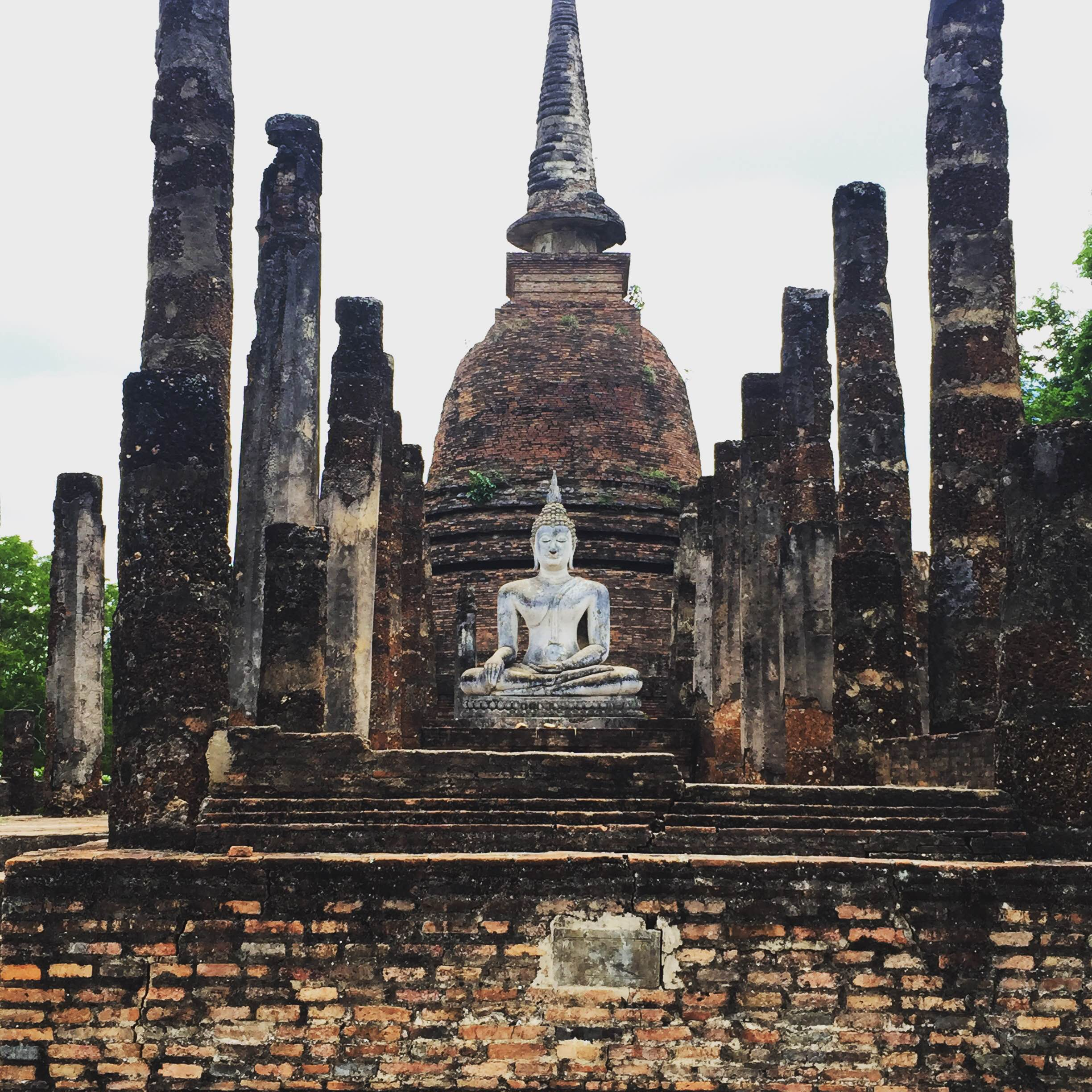 An incredible Buddha statue in the ancientruins of Sukhothai.