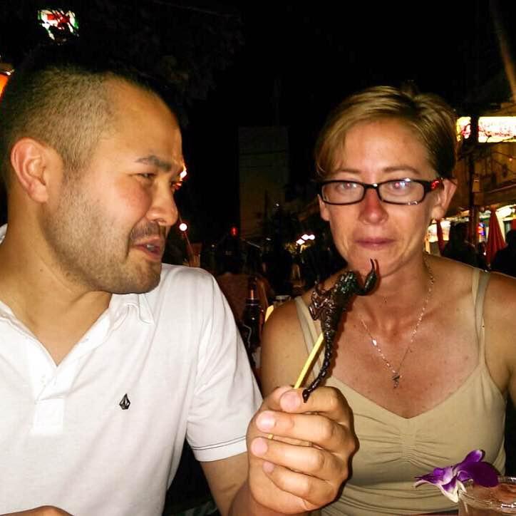 Me eating a friedscorpion on Khaosan Road in Bangkok. (It actually didn't taste bad).