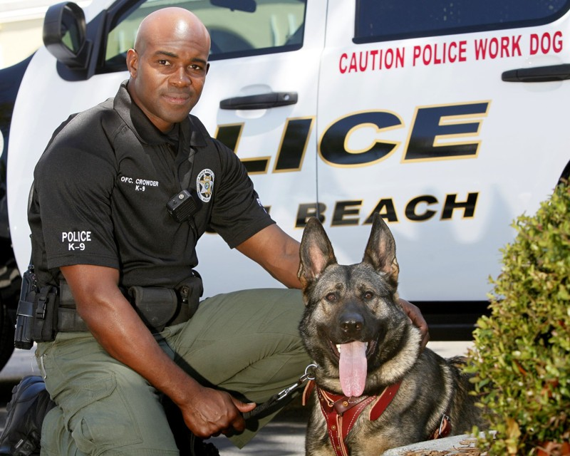 (Photo by Lannis Waters/The Palm Beach Post) BOYNTON BEACH - Daxxx with his partner, Officer Joseph Crowder.