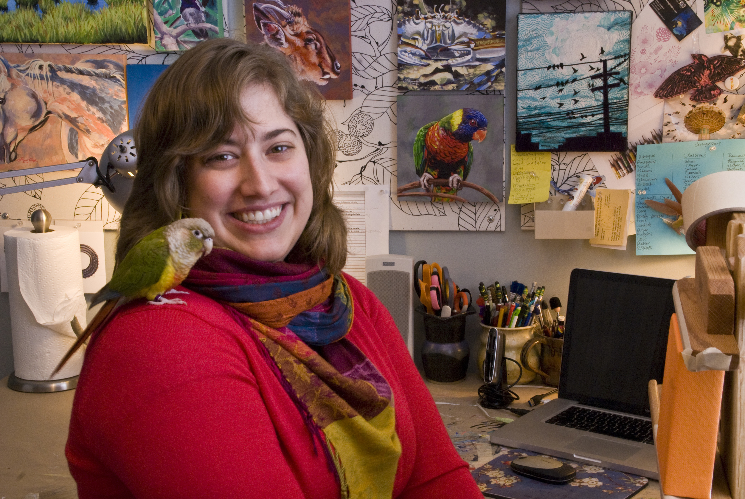 In my studio with my green cheek conure, Pippa.