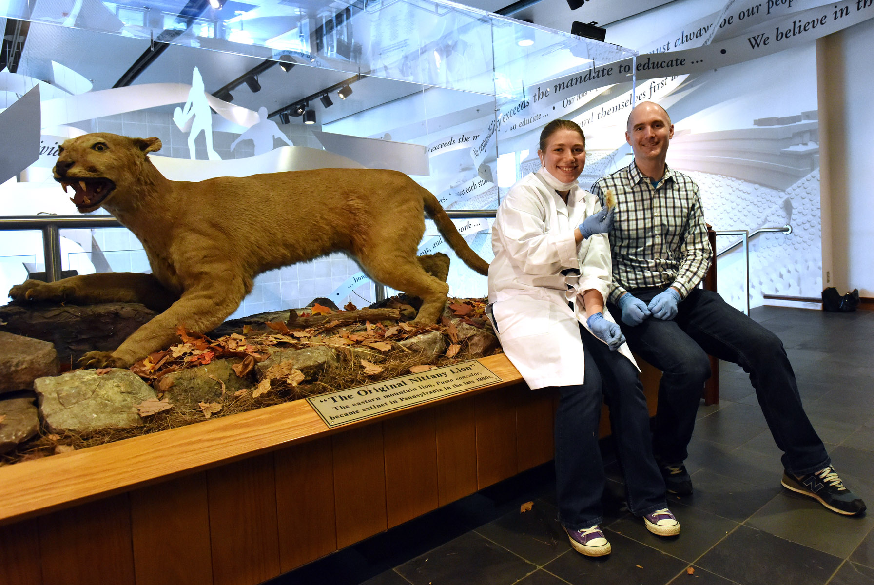 "Undergraduate student Maya Evanitsky with Dr. Perry after Maya sampled ""The Original Nittany Lion"" at the Penn State All Sports Museum for her ancient DNA study. Photograph: Pat Little, PSU."