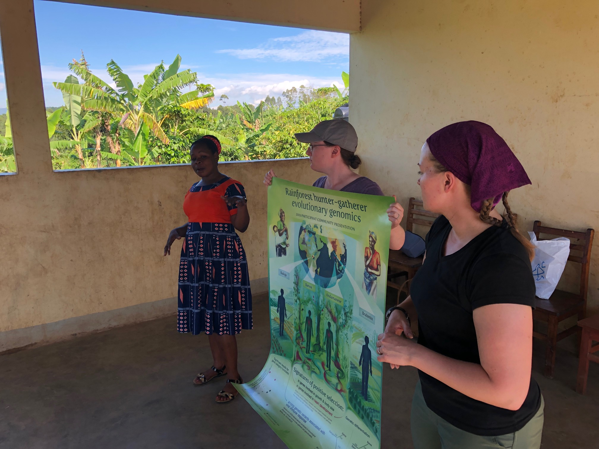 Lab postdocs Katie Grogan and Christina Bergey, with Sylvia Kokunda from the Batwa Development Program, presenting results from our hunter-gatherer genomics research to Batwa participant communities.