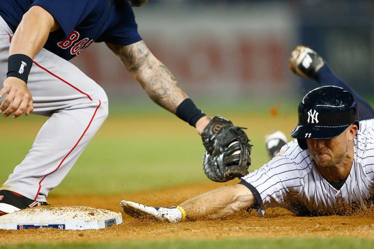 New York Yankees left fielder Brett Gardner (11) is tagged out by Boston Red Sox first baseman Mike Napoli (12) in the 17th inning as he tries to beat it back to first base at Yankee Stadium. Bronx, NY  4/11/15  (Photo Credit: Saed Hindash)