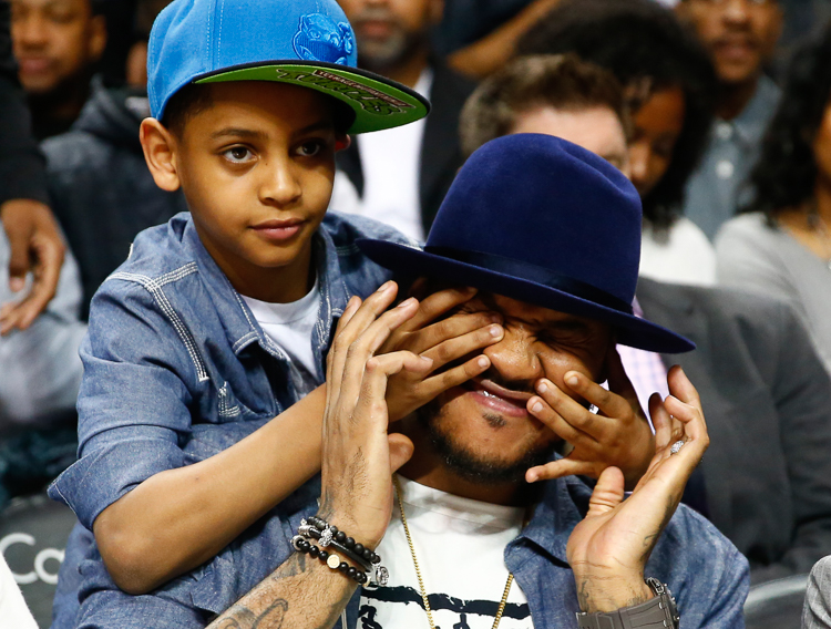 New York Knicks Carmelo Anthony had his son Kiyan with him court side trying to watch the final minutes of the 2015 Jordan Brand All-American Boys National Game at the Barclays Center. Brooklyn, NY  4/17/15  (Photo Credit: Saed Hindash)
