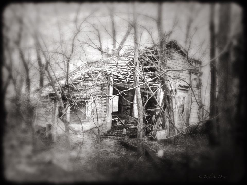 Rural House, Daddy's Still Story  [Photo Credit: Rad A. Drew]   Upon seeing the old place I felt a tug inside, and the metallic taste -- the one that comes just before you wretch -- filled my mouth. I had to swallow hard. Although it had been more than thirty years since I'd set foot on the old homestead, I could hear the crackle of the flames under Daddy's still, and smell the pungent sweetness of corn mash. How many times had Lila and I hidden in the corn crib out back as Daddy railed at imagined foes while under the spell of his White Lightning?