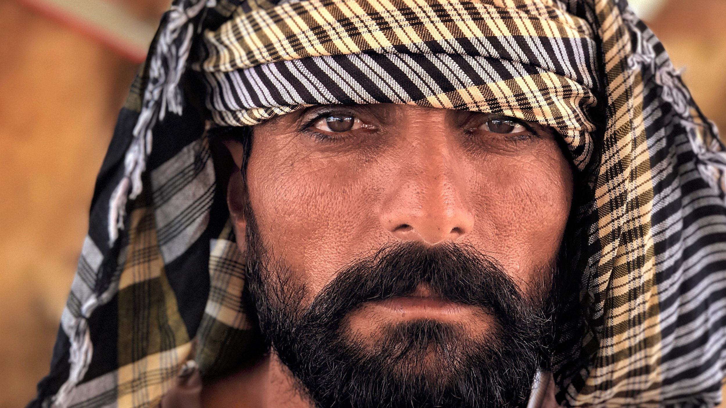 Afghani Camel Man  [Photo Credit: Rad A. Drew]
