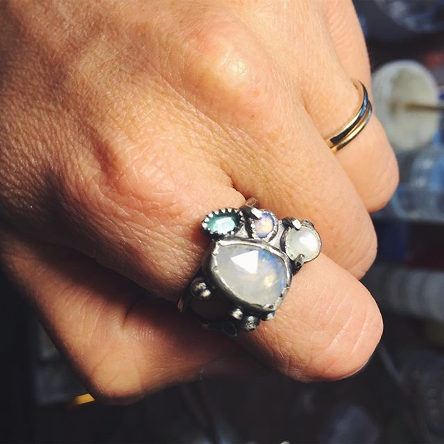Throwing it back to this one of a kind cluster style ring I made a couple years ago. I love these and I'll be making more soon! What stone/color combinations would make your perfect ring? Tell me in the comments below. . . . . . . #ring #jewelry #cluster #clusterring #moonstone #opal #apatite #motherofpearl #sterlingsilver #ericafreestone