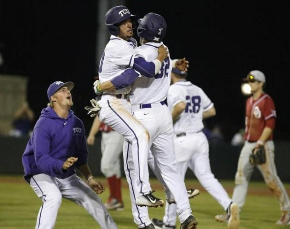 Dane Steinhagen, left, embraces Jeremie Fagnan (Calgary, Alta.) after Fagnan's game-winning hit in the 10th as the TCU Horned Frogs walked off a win over the Oklahoma Sooners. Photo: Ron T. Ennis, Fort Worth Star-Telegram.