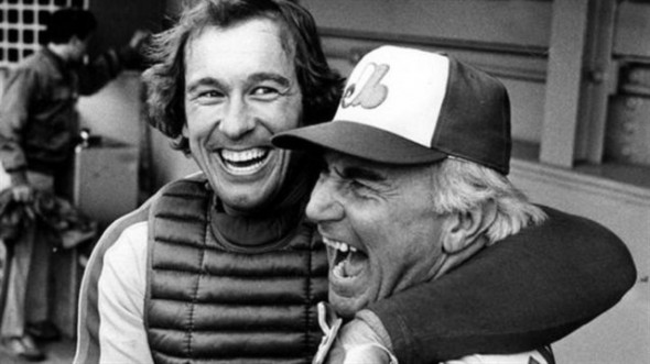 Gary Carter hugs manager Jim Fanning after the Montreal Expos advanced into post-season play.