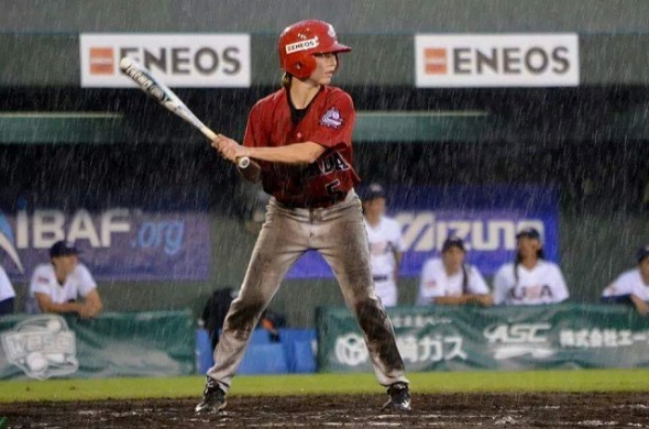 2B Nicole Luchanski (Edmonton, Alta.) is a woman for all seasons shown here hitting in the wet of the Worlds championship at Miyazaki, Japan. Luchanski has had help on her way to the Pan Am Games this summer in July. Photo: Alexis Brudnicki.