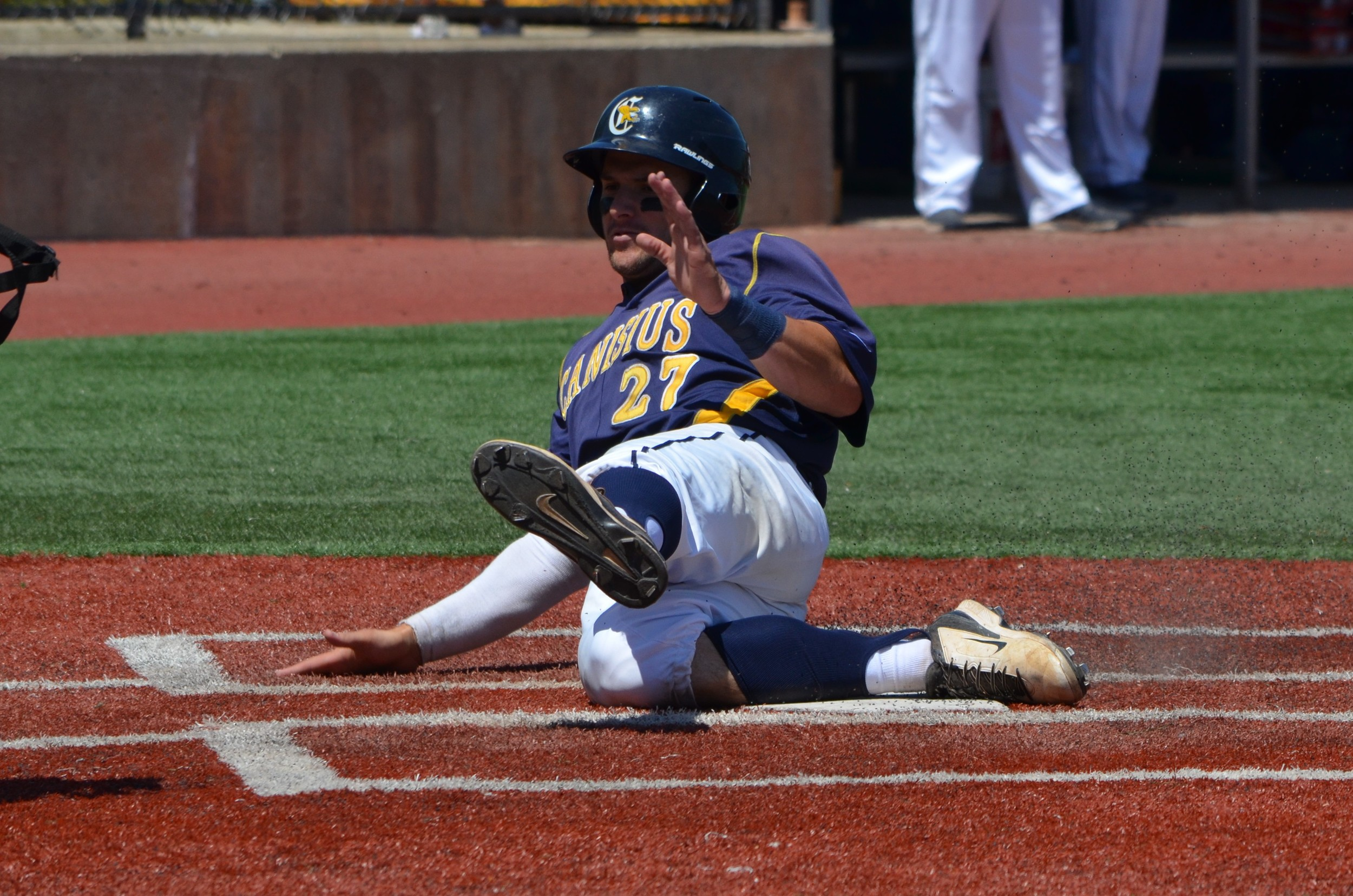 Connor Panas, shown here sliding in safely earlier this month against Niagara, played in his final college game for the Canisius College Golden Griffs, beaten 12-6 by the Oregon Ducks. Photo: Alexis Brudnicki.