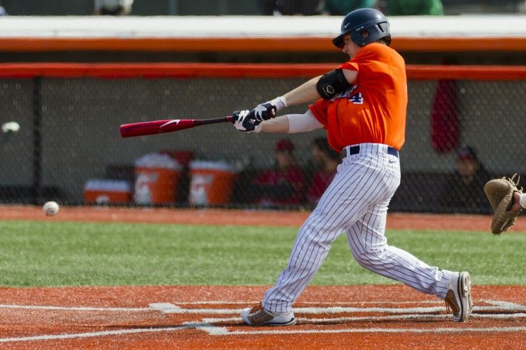 Kelly Norris-Jones (4) hits the ball during a Illini 15-4 victory over Mississippi Valley State. Photo: Brent Hofacker