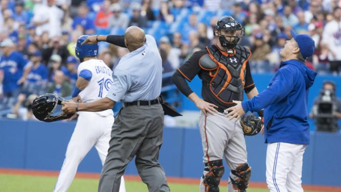 Plate ump C.B. Bucknor tosses Blue Jays manager John Gibbons after he argued when warnings were issued Friday after Mike Wright hit Jose Bautista with a pitch.