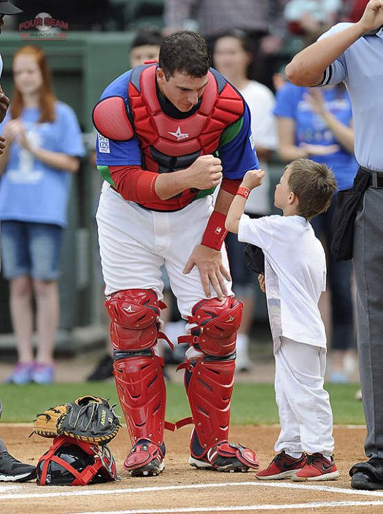 C Jordan Procyshen (Oktoks, Alta.) of the Greenville Drive wishes a fan good luck before a game against the Augusta GreenJackets at Fluor Field at the West End in Greenville, SC. Procyshen was promoted to class-A Salem. (Tom Priddy/Four Seam Images)