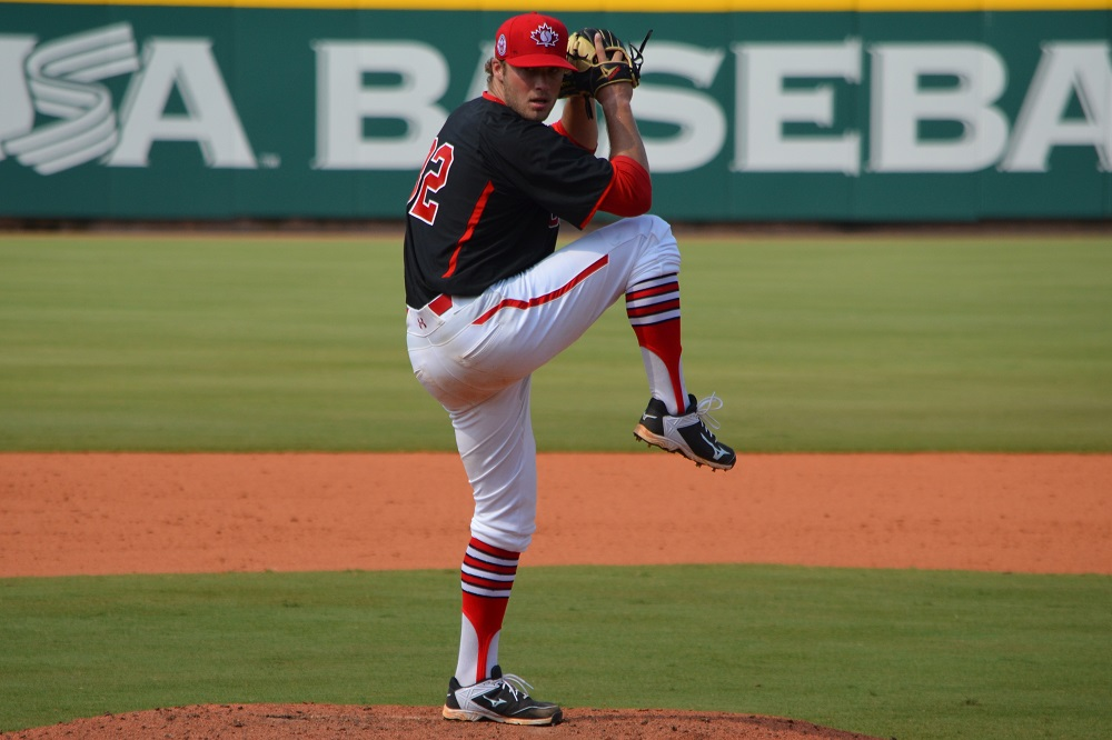 LHP Shane Dawson (Drayton Valley, Alta.), shown here in Cary, NC, worked 5 1/3 scoreless in Canada's first loss of pool play Saturday, a 4-1 setback to the USA. Photo: Alexis Brudnicki.
