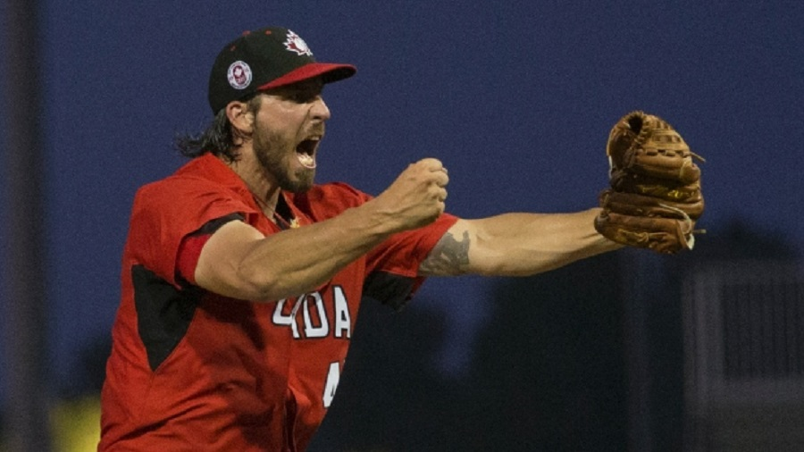 RHP Phillippe Aumont (Gatineau, Que.) celebrates after his eighth-inning strike out stranded the bases loaded with Puerto Rico base runners.