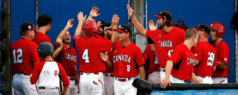 Greg Hamilton, Baseball Canada`s director of national teams, is the man behind the scenes recruiting players to wear the red and white. In this rare photo Hamilton (8) is in the forefront of the picture.
