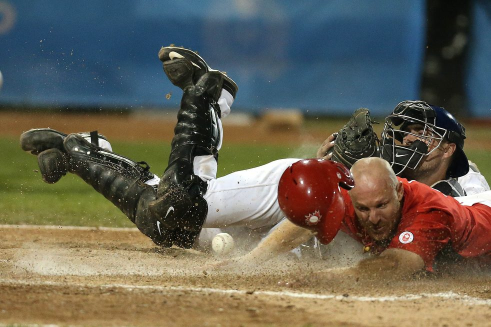 Peter Orr (Newmarket, Ont.) arrives in a cloud of dust -- with the winning run in the bottom of the 10th as Canada edged Team USA 7-6 in the Pan Am gold medal game.