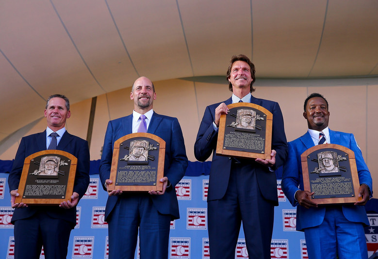 HOFers Craig Biggio (from left to right), John Smoltz, Randy Johnson and Pedro Martinez with their plaques.