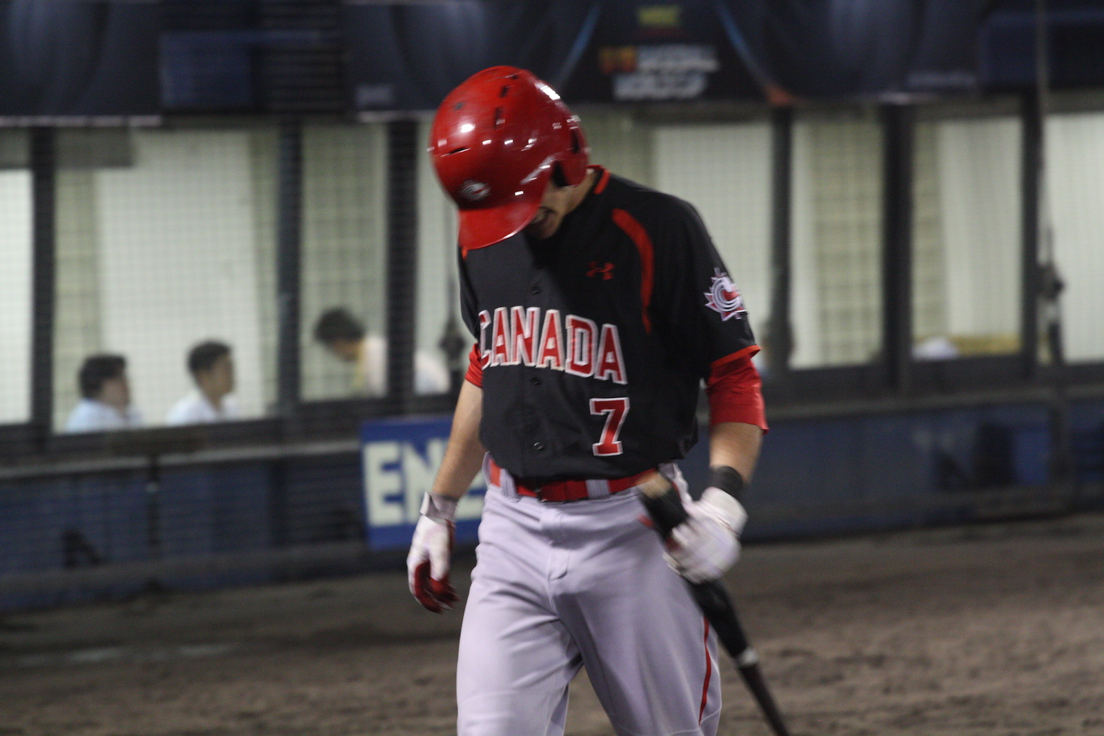 Peter Hutzal (Calgary, Alta.) returns to the dugout after an out, following same line his teammates followed in a 5-2 loss to Japan.
