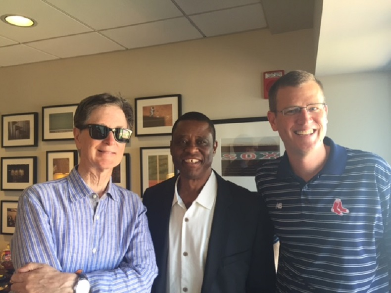 Boston Red Sox president John Henry, Warren Cromartie of the Montreal Baseball Project and Sam Kennedy, CEO of the Red Sox visit at Fenway Park.