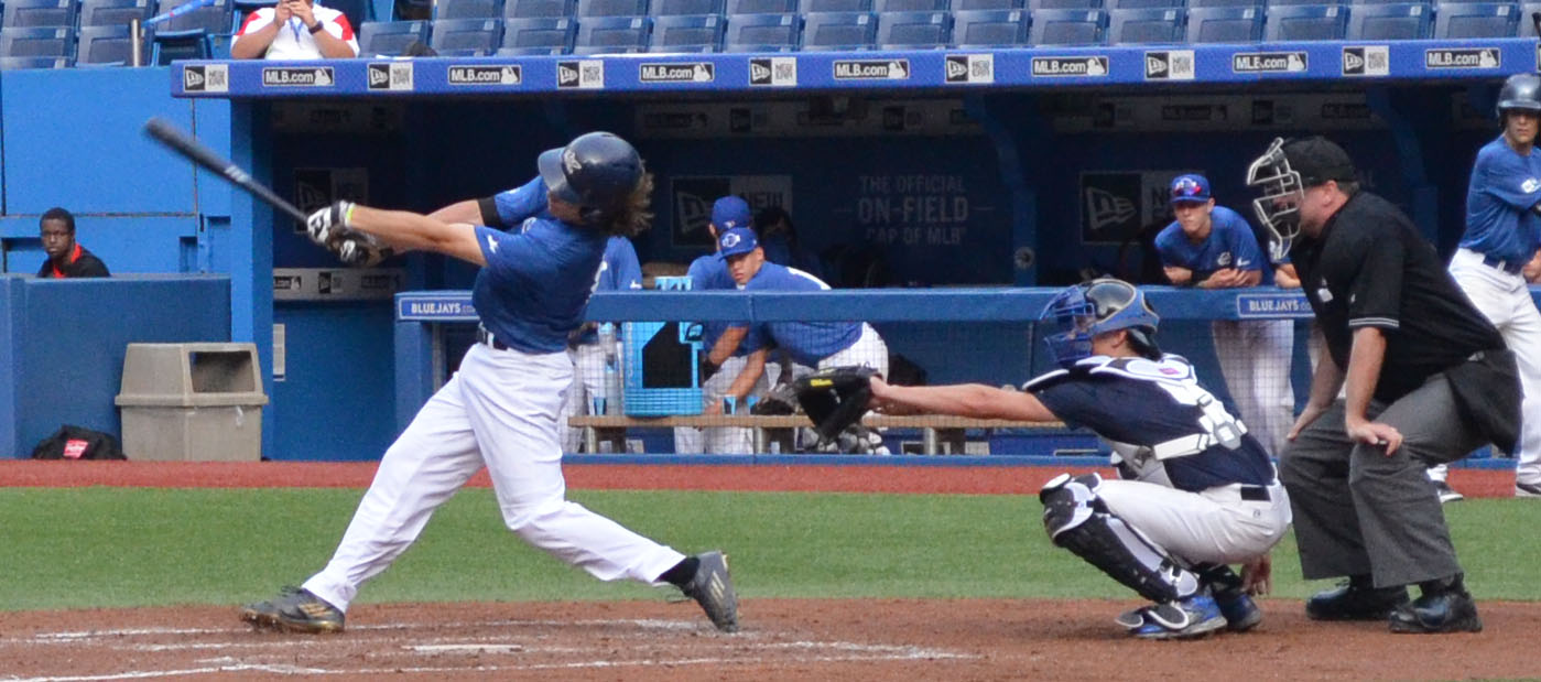 Quebec Blue's Edouard Julien (Quebec City, Que.) gets one of his two hits versus Futures Navy   Tuesday   evening at the Rogers Centre. Photo Credit: Mitch Sanderson