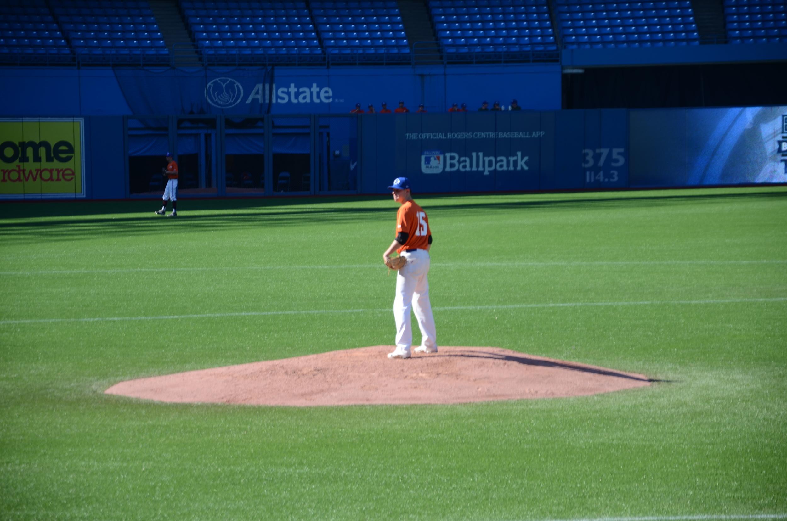 British Columbia Orange starter Tyler Hoefer (Delta, BC) of the North Delta Blue Jays readies himself to deliver a pitch. Photo:Brandan Kajioka