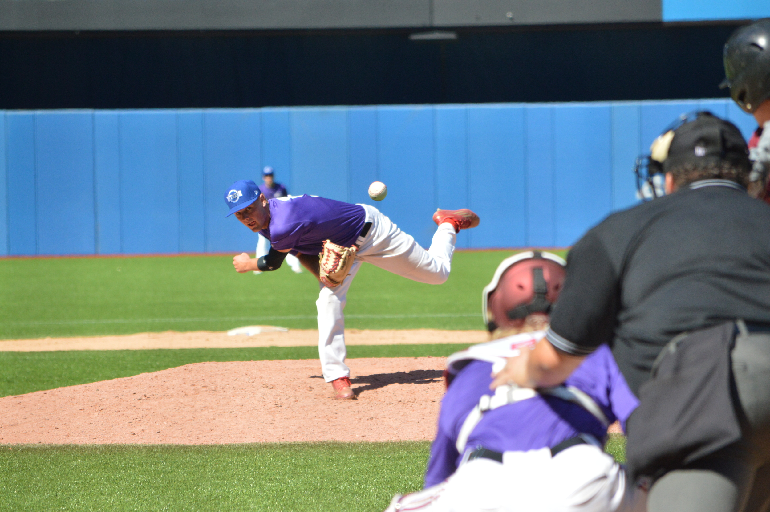 Prairies Purple starter Brody Frerichs (Muenster, Sask.) of the Meunster Red Sox, finishes his delivery against Atlantic Maroon. Photo Credit: George Redak