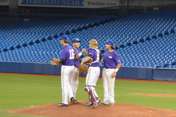 Prairies Purple players celebrate on the mound following an upset win over Ontario Green. Photo Credit: Leah Smith