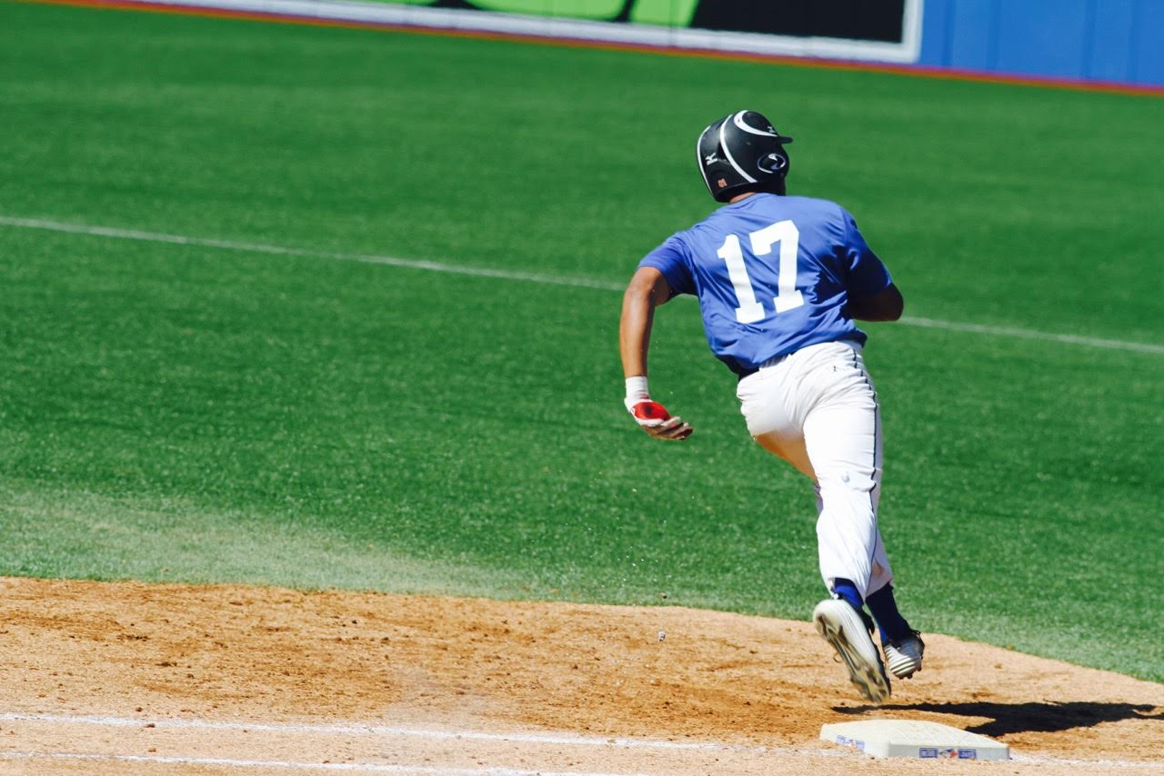 OF Isaac Deveaux barrels around first base during Tournament 12 play at the Rogers Centre. Photo: Tyler King.