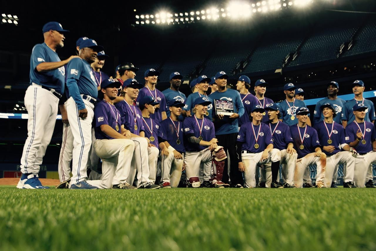 Prairies Purple champions pose with commisioner Robbie Alomar and the alumni who took part in the five-day Tournament 12. Photo: Tyler King.