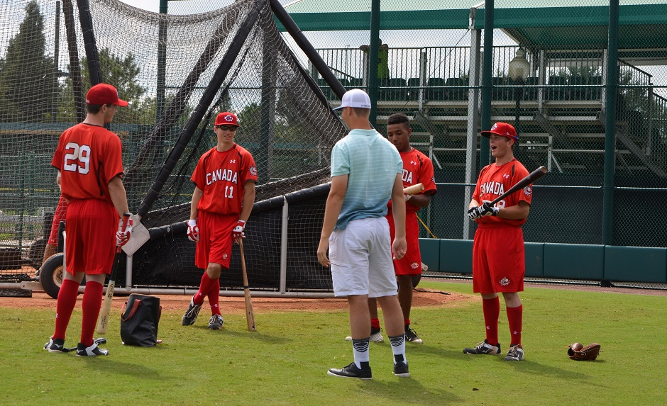 Atlanta Braves RHP Mike Soroka (blue) chats with members of the Junior National Team after pitching two scoreless inning. Photo: Alexis Brudnicki.