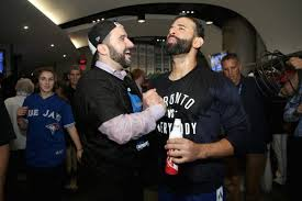 Former Blue Jays GM Alex Anthopoulos in happier times with slugger Jose Bautista.