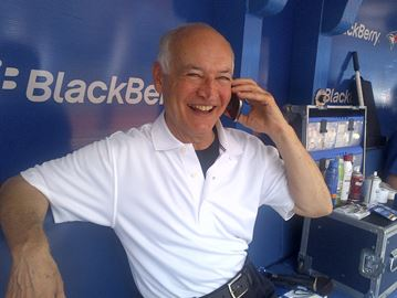 Jays broadcaster Jerry Howarth is either talking baseball on the radio or talking ball on a borrowed cell phone. Photo: Jay Stenhouse Studios.