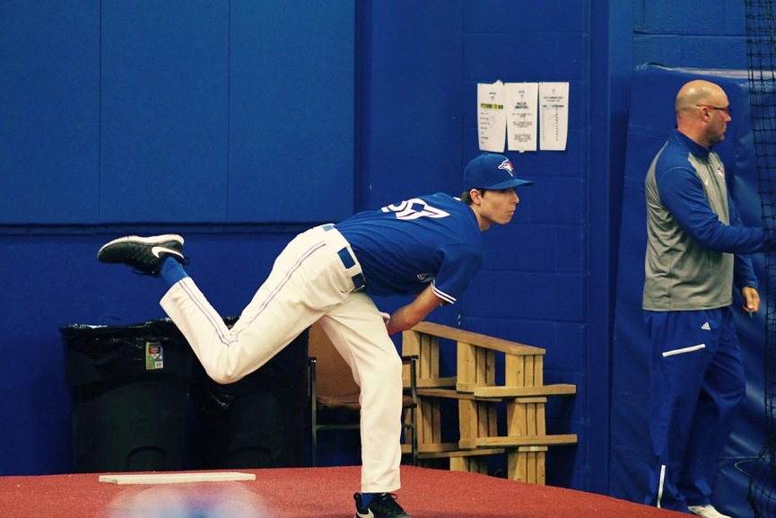 RHP Jordan Balazovic (Mississauga, Ont.) of the Ontario Blue Jays threw a bullpen with pitching coach Mike Steed watching.